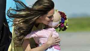 The Duchess of Cambridge hugs six-year-old Diamond Marshall as the Royal Couple arrives in Calgary Thursday, July 7, 2011.