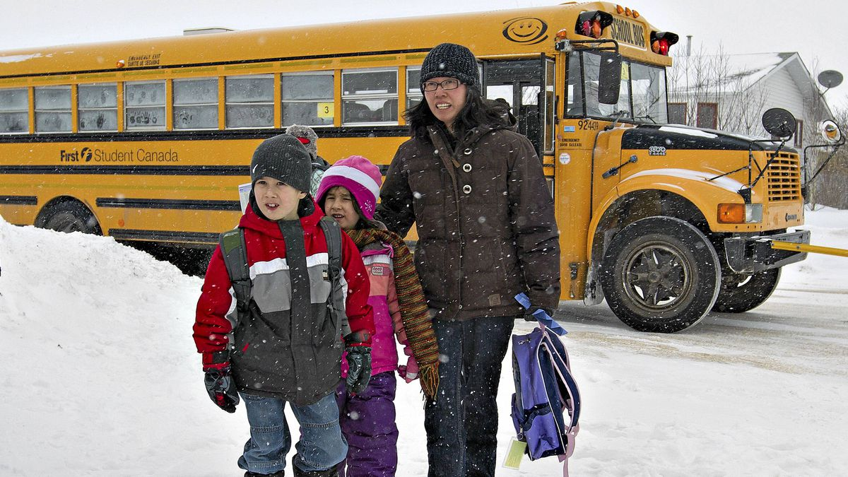 Marjorie Kirsop walks with her kids Paul 7, (left) and Sarah 5, Kirsop after the school bus from Notre Dame Elementary School dropped them off near her home in Morinville on Wednesday March 2, 2011.