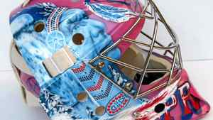 One of Price's many masks that commemorates his First Nations' heritage and his commitment to Breast Cancer research.