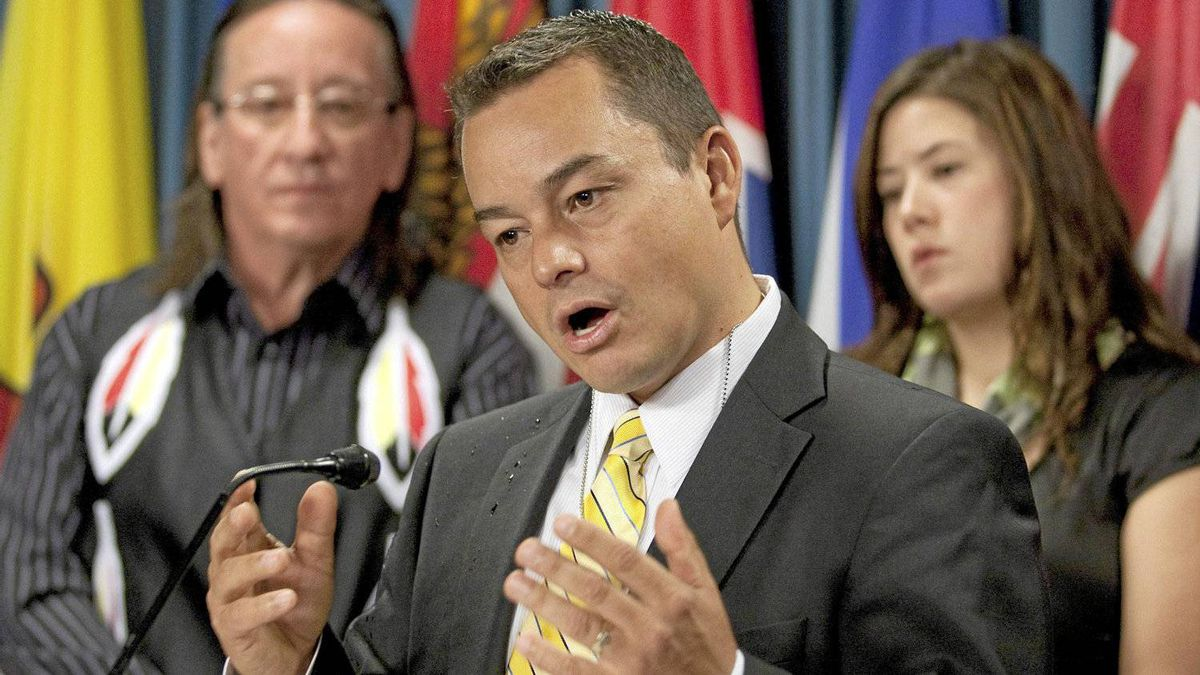 Assembly of First Nations National Chief Shawn A-in-chut Atleo speaks with media as Kitigan Zibi Anishinabeg First Nation Chief Gilbert Whiteduck (left) and nation AFN youth representative Kluane Adamek look on during a news conference in Ottawa, Tuesday September 21, 2010.