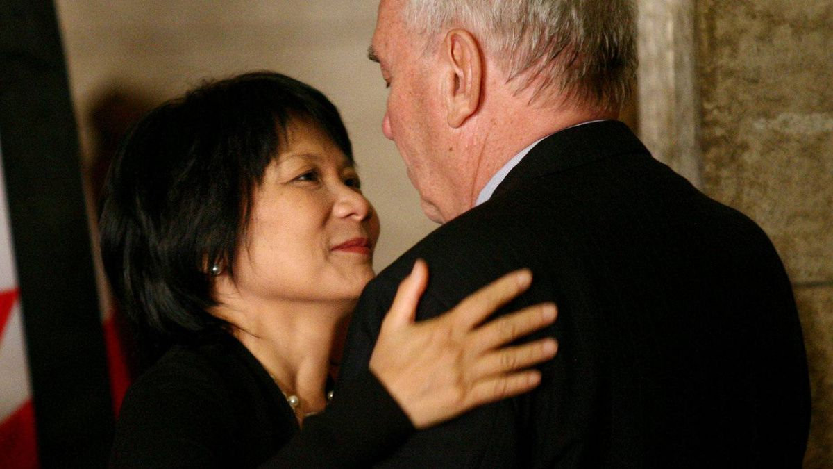 MP Olivia Chow embrace former NDP leader Ed Broadbent next to the casket of NDP leader Jack Layton on Parliament Hill.