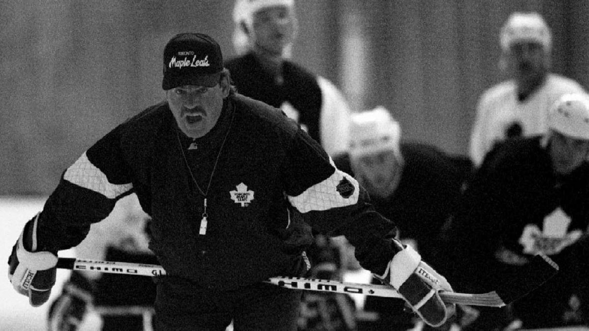 Toronto Maple Leafs coach Pat Burns shouts to players during his team's training session at the Alexandra Palace ice rink, September 8. Maple Leafs are preparing for two exhibition games next weekend against New York Rangers. ac/Andre Camara REUTER