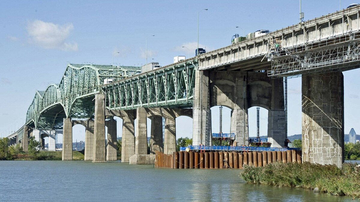 Repair work continues on the Champlain Bridge crossing the St. Lawrence in Montreal on Oct. 5, 2011.