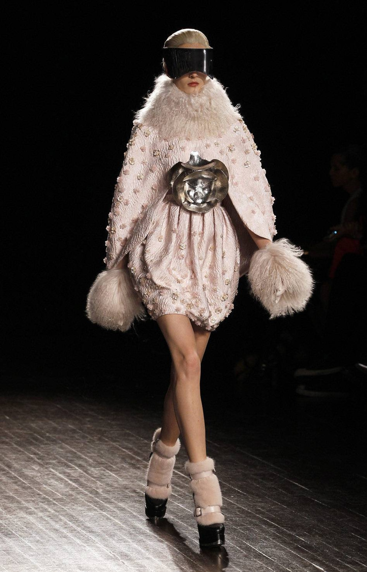 On the penultimate night of Paris Fashion Week, the fashion world was left breathless over the beauty of Sarah Burton's collection for Alexander McQueen. The show began with coatdresses that boasted the fragile sculpting of biscuit porcelain and sumptuous Mongolian fur. Oh, and high-gloss visors.