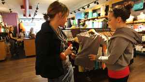 Lululemon refers to its store clerks as 'educators.' The company says its goal is to train its staff so well they can positively influence their families and communities as well as customers coming into the stores. Here, employee Laura Stuve, right, tells customer Maureen Eyers about the features of a yoga top.