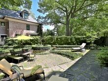 The a landscaped backyard with a stone terrace and water fountain was a prime selling point for  44 Old Bridle Path in Toronto.