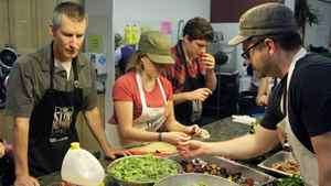 Stop Community Food Centre Founder Nick Saul, volunteer Christina Palassio, volunteer David Protetch and Chef Scott MacNeil prepare lunch at the kitchen of the community centre on Davenport Rd.