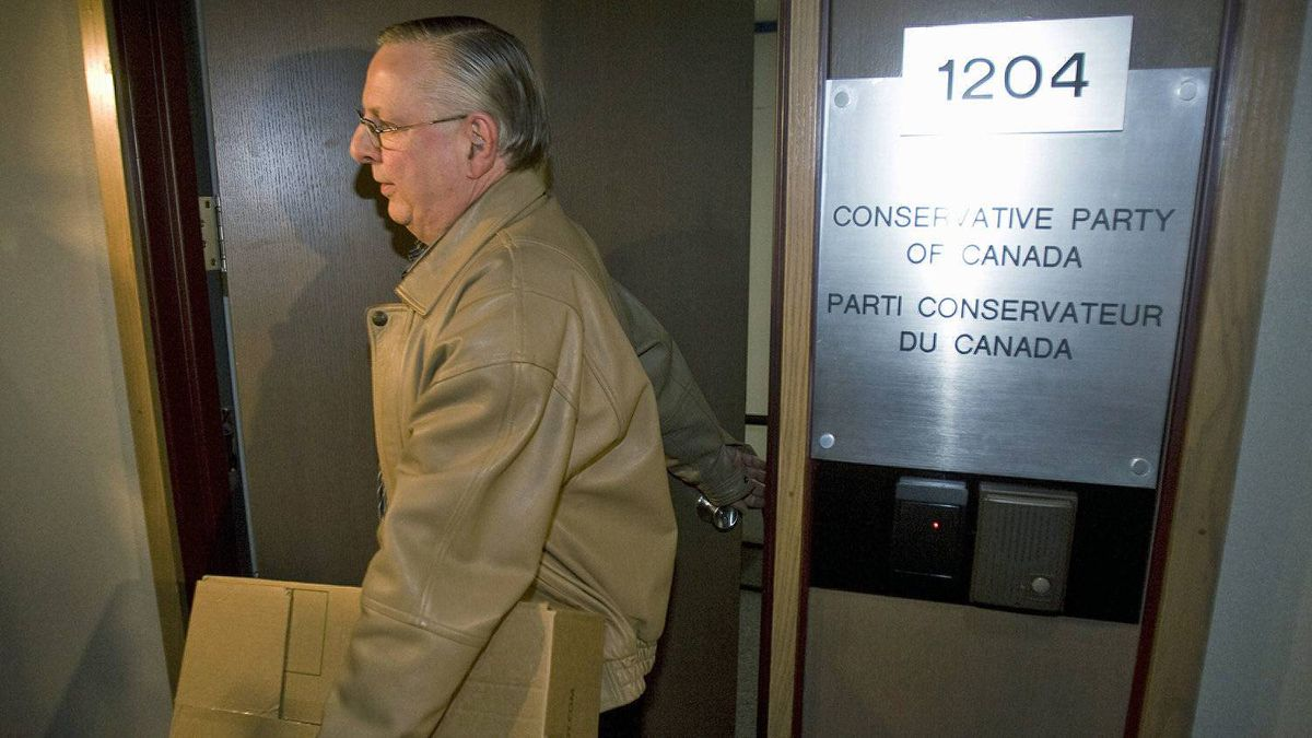 An Elections Canada official removes a box of files from Conservative Party headquarters in Ottawa on April 15, 2008.