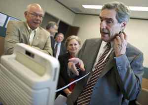 Liberal Leader Michael Ignatieff tests a new medical device from Mespere Life Sciences during a campaign-style stop at the Accelerator Centre, a small high-tech incubator facility in Waterloo, Ont., on Sept. 8, 2009.