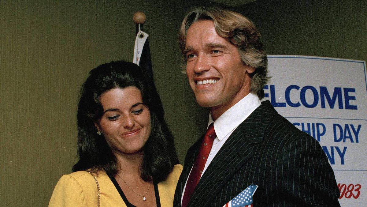 In this Sept. 16, 1983 file photo, actor and bodybuilder Arnold Schwarzenegger shows off his new U.S. citizenship papers (not pictured) as Maria Shriver, daughter of Sargent and Eunice Shriver, looks on at the Shrine Auditorium in Hollywood, Calif. Schwarzenegger has announced Monday, May 9, 2011 that he and Shriver, his wife of 25 years, are separating.