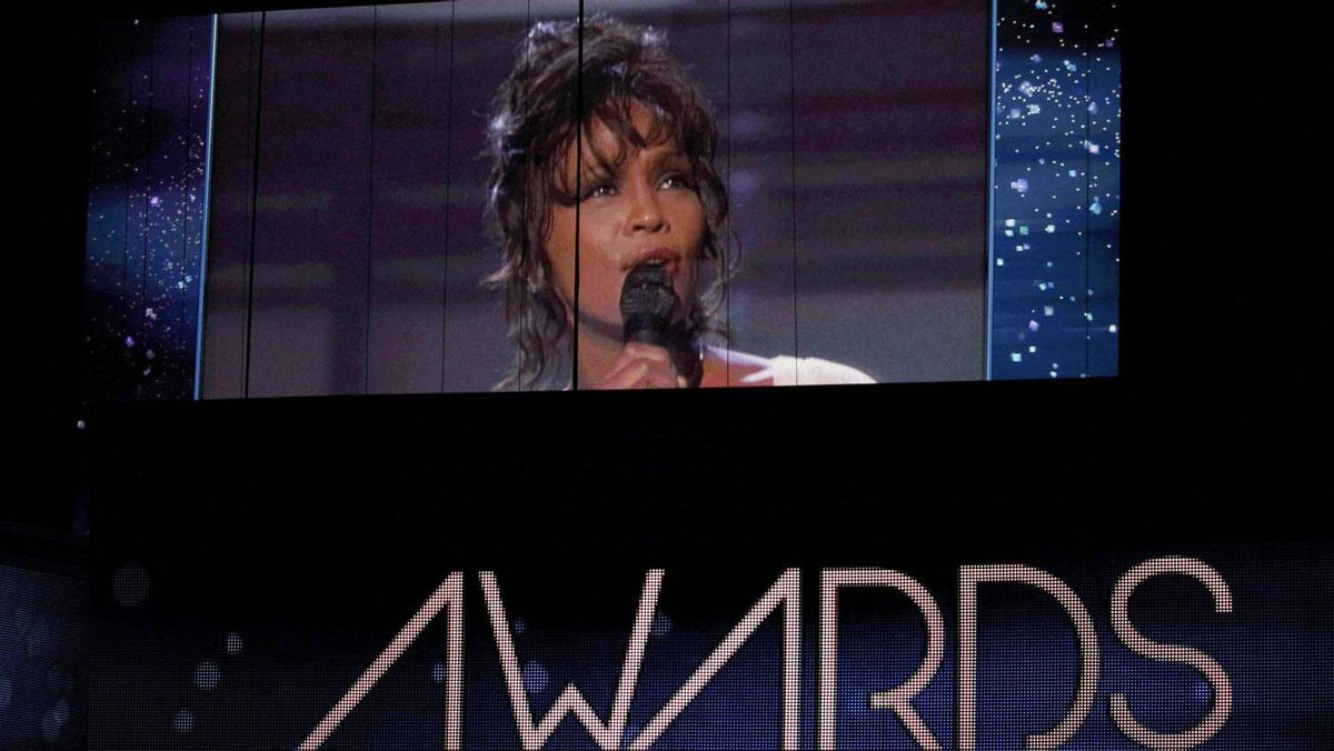Singer Whitney Houston, who died on Feb. 11, 2012, is shown on a video screen in a 1994 Grammy performance during the 54th annual Grammy Awards in Los Angeles on Feb. 12, 2012.