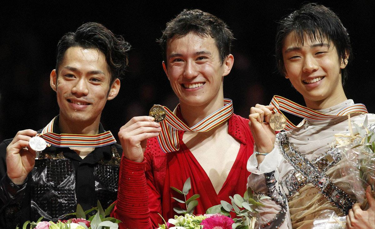 Daisuke Takahashi, left, of Japan, Patrick Chan, centre, of Canada and Yuzuru Hanyu of Japan celebrate during the medal ceremony for the men's event at the ISU World Figure Skating Championships in Nice March 31, 2012.