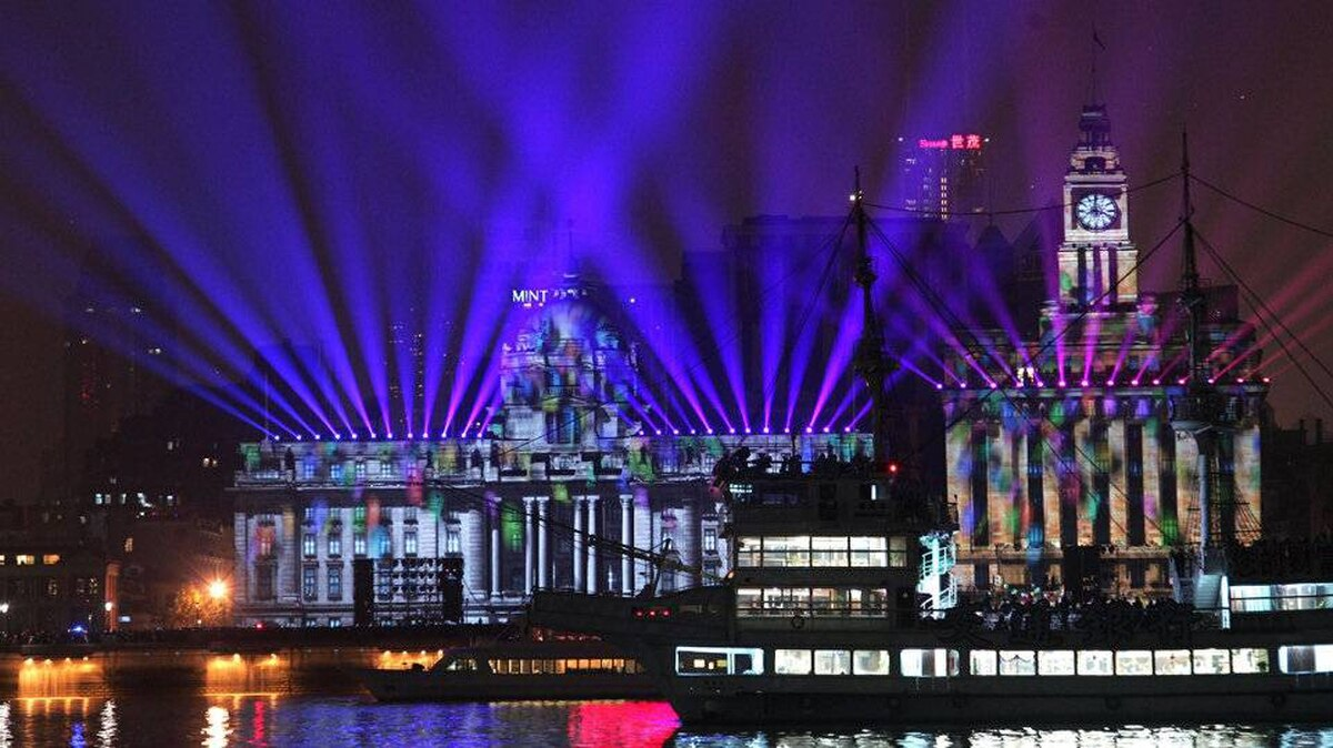 The Bund river front promenade, one of the most popular tourist destinations in Shanghai, is illuminated to celebrate the New Year on Saturday, Jan. 1, 2012.