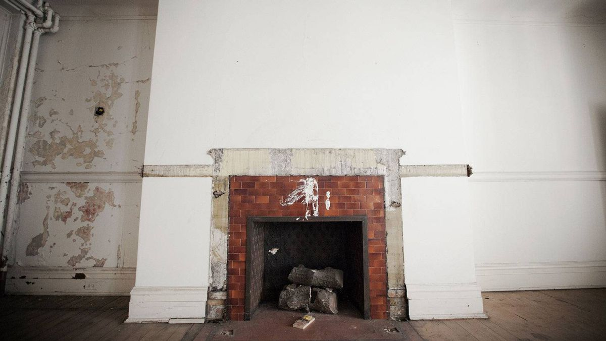 Ruins of a fireplace on the third floor. Note the rat trap: 'I have been told, particularly in the basement, there is a rat problem,' says Mr. Switzer.