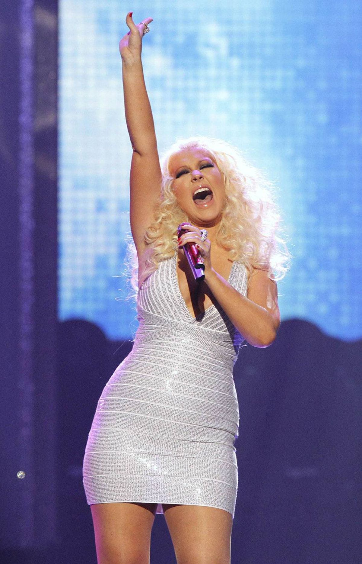 Singer Christina Aguilera performs with rock band Maroon 5 at the 2011 American Music Awards in Los Angeles November 20, 2011.