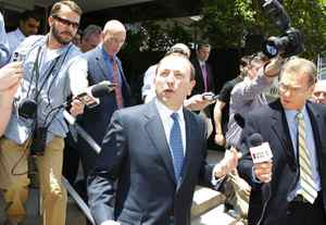 National Hockey League commissioner Gary Bettman walks out of Federal Bankruptcy Court during a break in Phoenix, Arizona June 9, 2009.