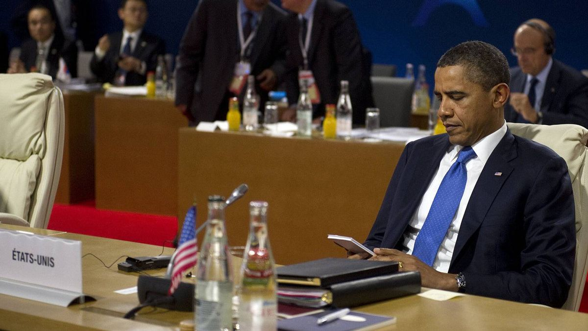 President Obama is seen reading over his notes prior to the start of a second round table meeting.