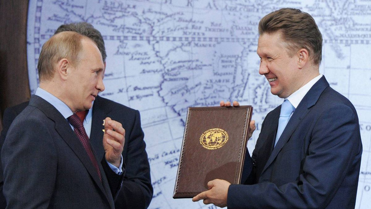 Russian President (then Prime Minister) Vladimir Putin, left, gives a certificate to Russian gas monopoly Gazprom Head Alexei Miller at a ceremony in St. Petersburg, Russia, Tuesday, April 10, 2012.