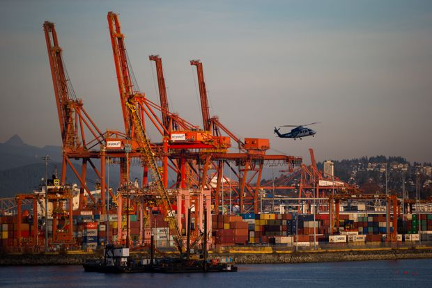 Canada's trade deficit narrows in October as both import and export volumes rise