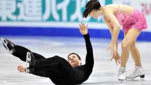 Scott Moir falls in front of his partner Tessa Virtue of Canada as they perform their short program in the ice dance competition at the ISU Grand Prix of Figure Skating Final Friday, December 9, 2011 in Quebec City. THE CANADIAN PRESS/Paul Chiasson