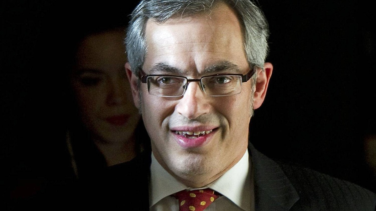 Industry Minister Tony Clement leaves the House of Commons on Feb. 8, 2011.