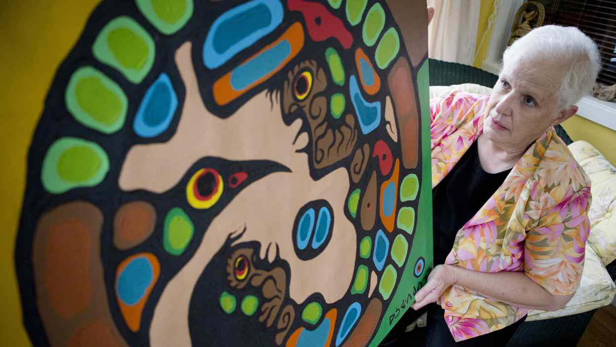 Maggie Hatfield, a 64-year-old retired teacher, shows the painting she believed was a 1979 canvas by Norval Morrisseau in her Sarnia, Ont., home on May 31, 2012.