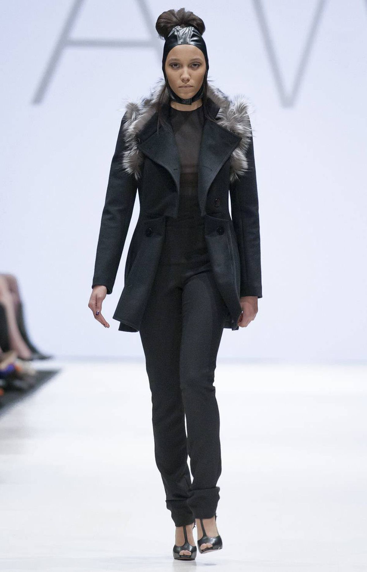 Fong's collection for VAWK, however, was designed for a different kind of working woman; specifically, a 'Sci-Fi Samurai' unafraid to don leather headgear, statement coats and flashy gowns to get the job done.