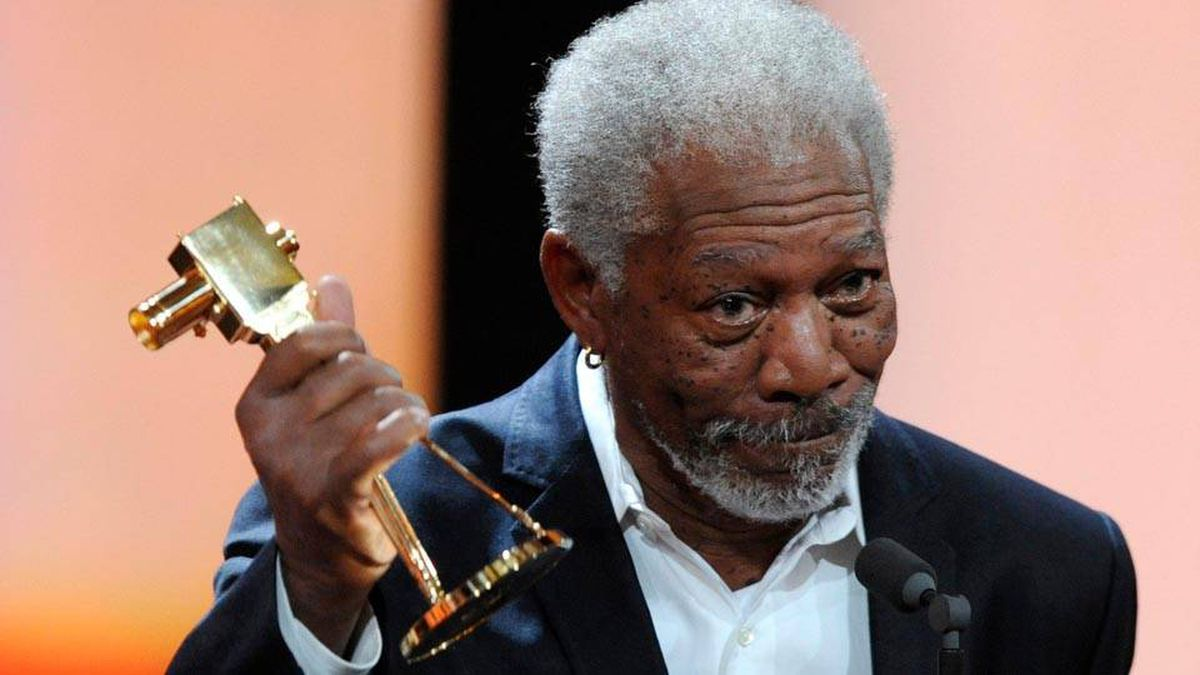 "US actor Morgan Freeman holds his trophy in the category ""International Lifetime Achievement"" during the 47th Golden Camera award ceremony in Berlin, Feb. 4, 2012."