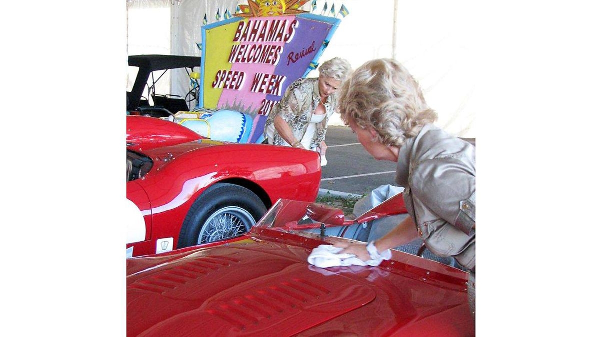There are ladies who lunch, but in the vintage car world they're more often ladies who polish. These stylishly turned out co-drivers are putting a final shine on their rides before heading to the concours d'elegance event.