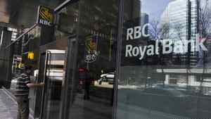 A man walks into a Royal Bank of Canada (RBC) in Toronto.