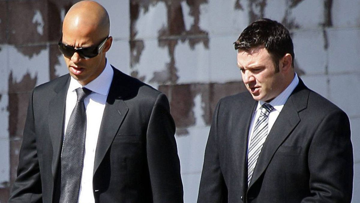 Vancouver Canucks player Manny Malhotra, centre, attends the funeral service for former teammate Rick Rypien. THE CANADIAN PRESS/Jeff McIntosh