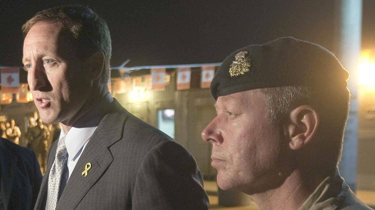 Canada's Minister of Defence Peter MacKay, left, speaks to reporters at Kandahar Air Field as Major General Jon Vance looks on, on Saturday, November 12, 2011 in Kandahar, Afghanistan.