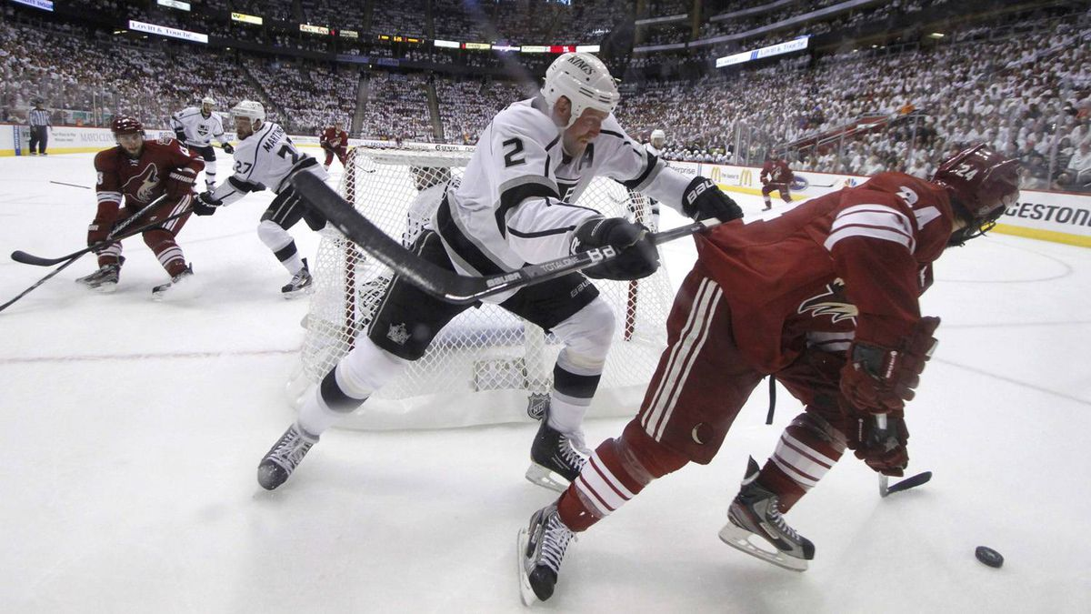 Phoenix Coyotes centre Kyle Chipchura (24) is checked by Los Angeles Kings defenceman Matt Greene (2) behind the Kings net in the 1st period during Game 5 of the NHL Western Conference hockey finals in Glendale, Arizona, May 22, 2012.