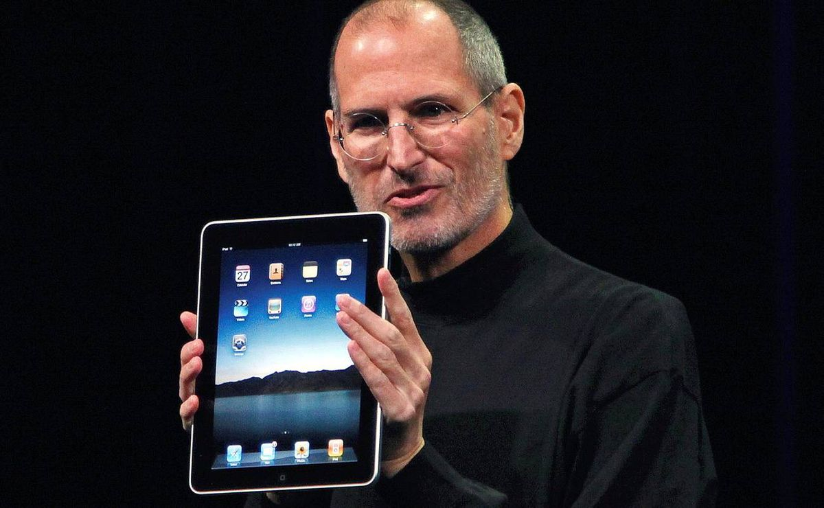 """Apple Chief Executive Officer Steve Jobs holds the new """" iPad"""" during the launch of Apple's new tablet computing device in San Francisco, California,"""