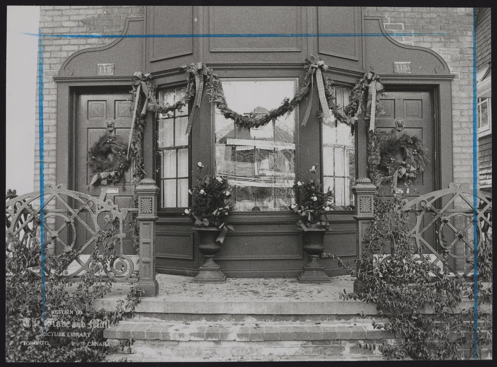 CHRISTMAS DECORATIONS Wreaths, ribbons and a cedar garland enhance traditional look of this bow window.