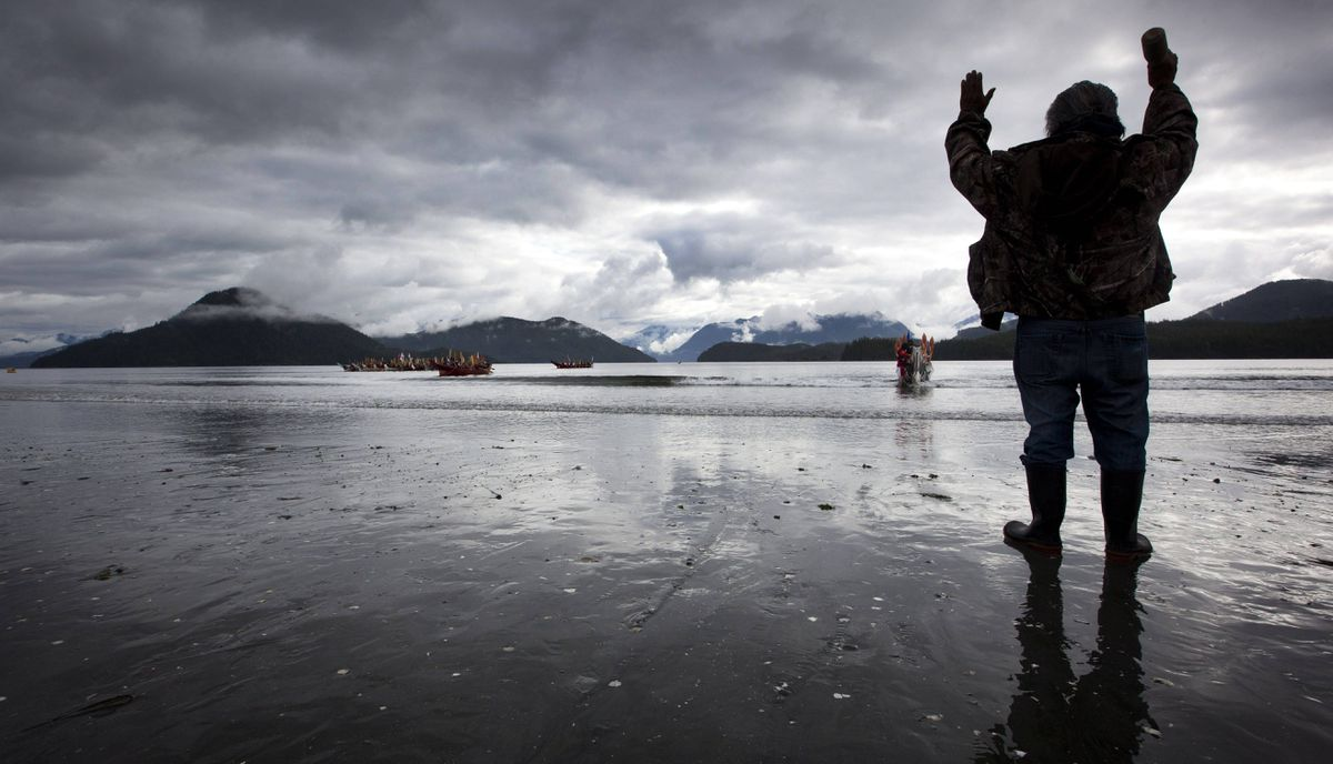 Louis Joseph an elder with the Ahousat, B.C. first nation says a farewell prayer as canoeist from The Pulling Together journey leave the Ahousat beach on their second day of their voyage.