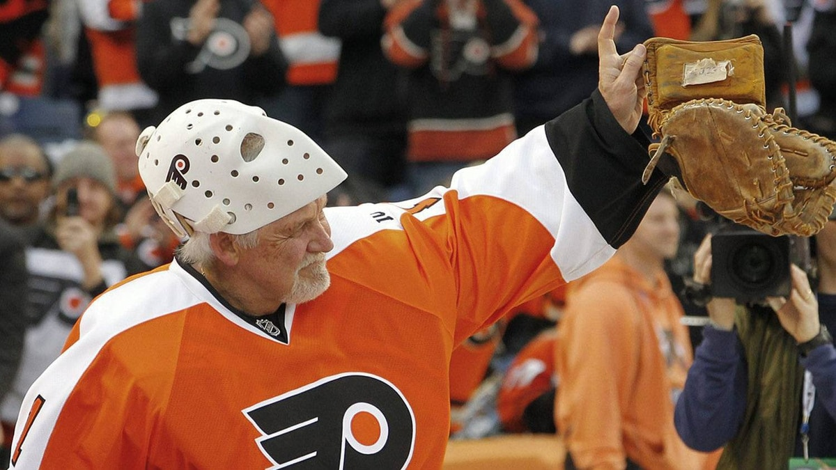 Bernie Parent, goalie for the Philadelphia Flyers alumni team, acknowledges the cheers of fans during his introduction at the Winter Classic Alumni NHL hockey game against the New York Rangers alumni team on Saturday, Dec. 31, 2011, in Philadelphia. (AP Photo/Tom Mihalek)