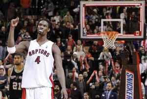 Toronto Raptor Chris Bosh celebrates defeating the San Antonio Spurs after their NBA game in Toronto on Jan. 3, 2010. Bosh became the all-time leading scorer for the franchise in the game.