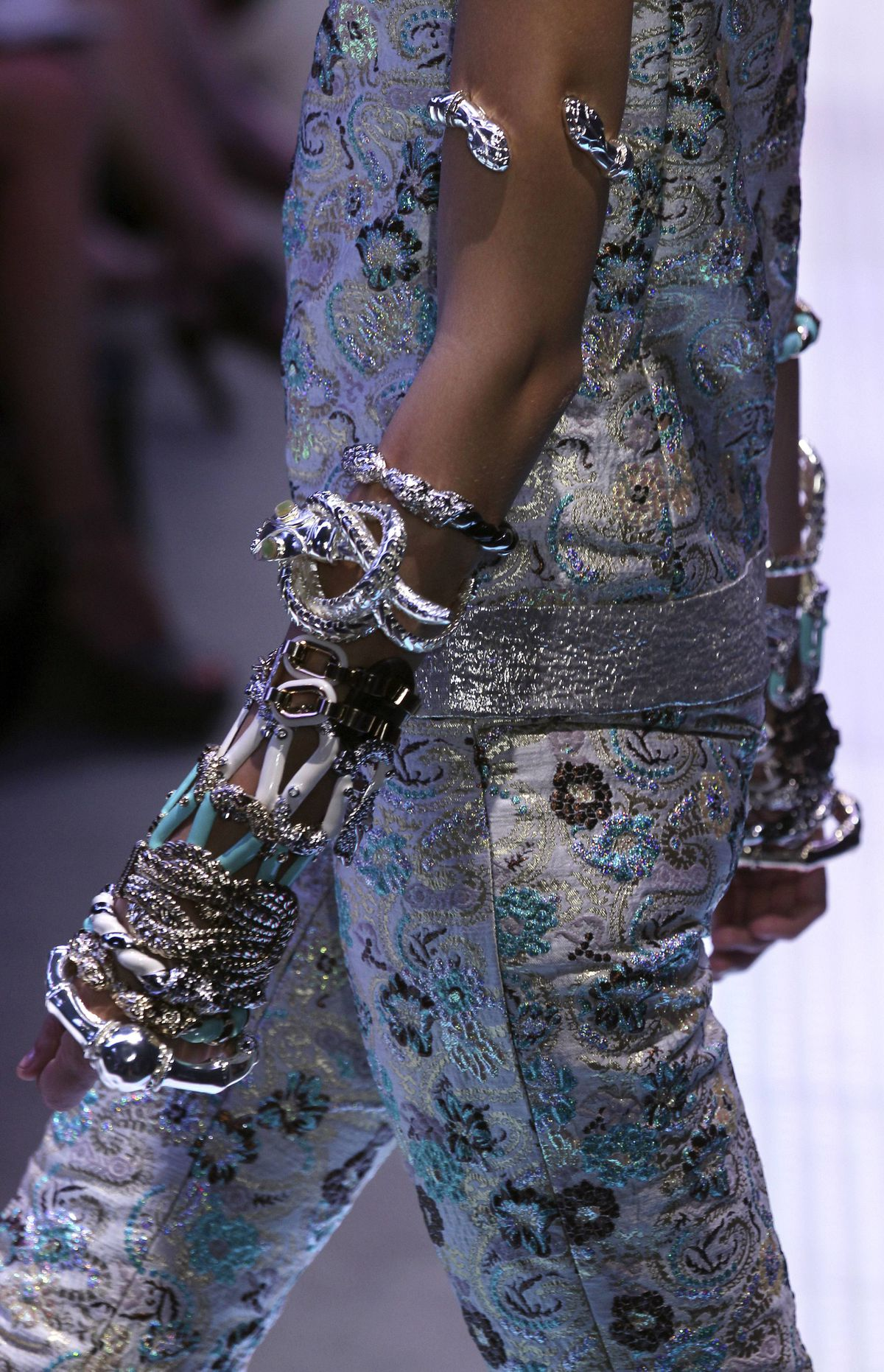 Ever the maximalist, Valli layered bangle upon cuff upon bracelet toward the end of the collection. Because nothing says edgy socialite like an arm adorned in precious metal and stone.