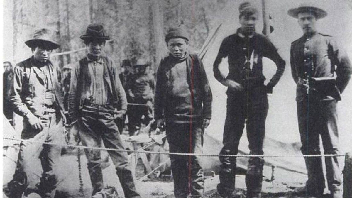 The four Nantuck brothers in custody at Tagish Police Post, summer of 1898. They were arrested for the murder of a prospector named William Meehan. Two of the brothers, Dawson and Jim were subsequently hanged in Dawson City, August 4, 1899.