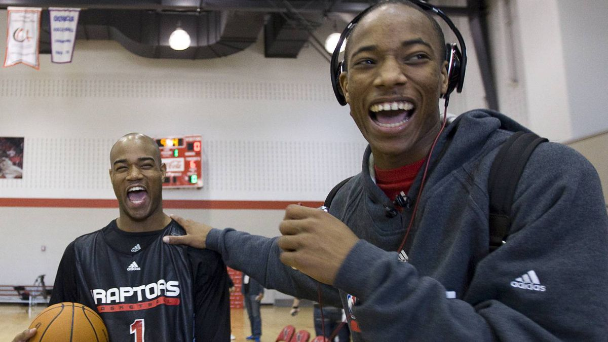 Toronto Raptors' Jarrett Jack, left, laughs with Demar DeRozan as they joke around at the end of practice on the second day of training camp in Ottawa, Ont., Wednesday September 30, 2009. THE CANADIAN PRESS/Sean Kilpatrick
