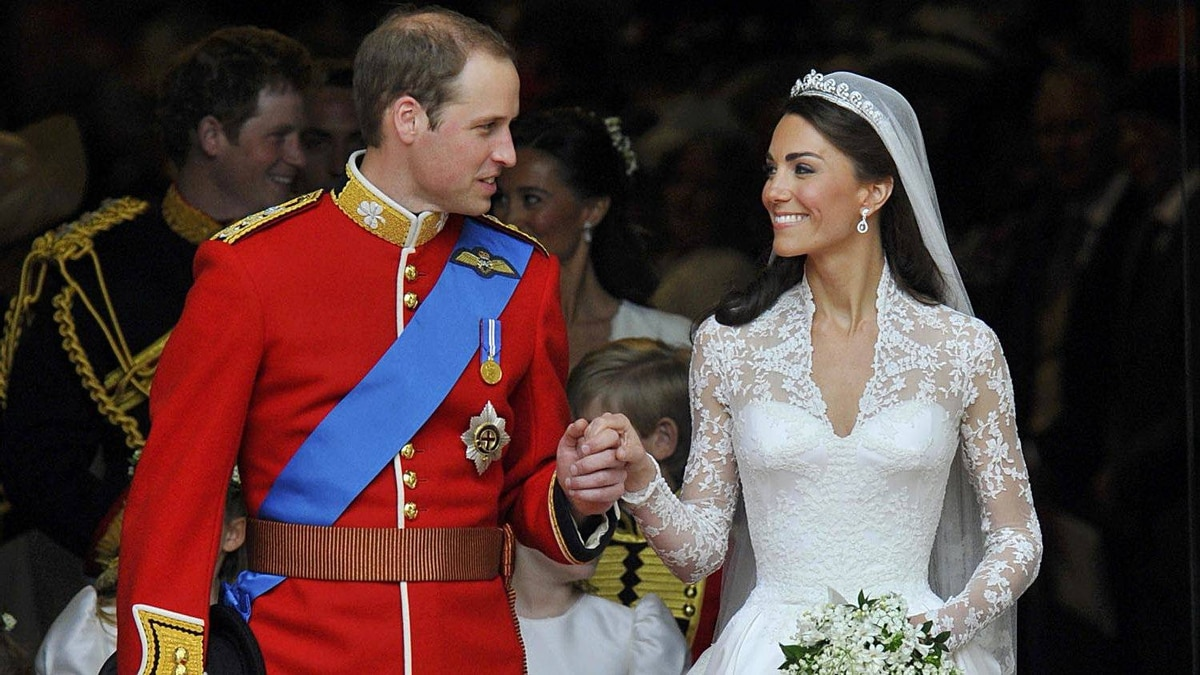 Britain's Prince William and Catherine, Duchess of Cambridge, look at one another after their wedding ceremony in Westminster Abbey, in central London April 29, 2011.