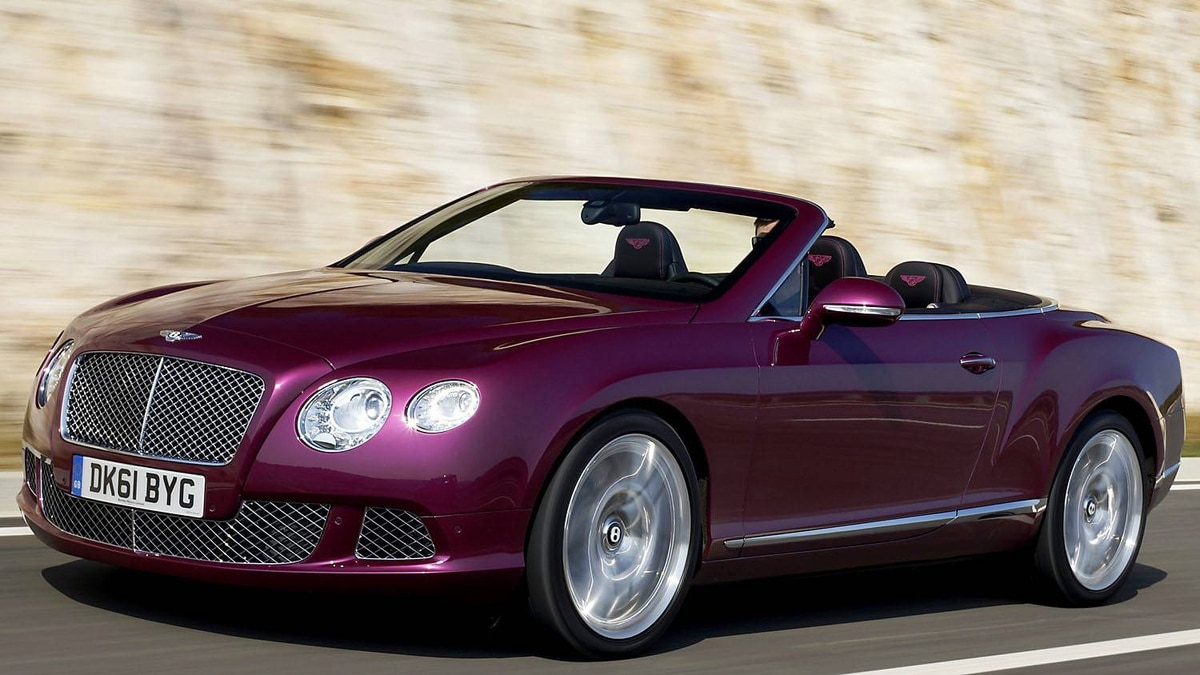 2012 Bentley Continental GTC in magenta. The car's front suspension has four link double wishbones, computer controlled self-levelling air suspension, with anti roll-bar.
