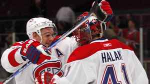 Montreal Canadiens Andrei Markov (L) celebrates with goaltender Jaroslav Halak (R) at the conclusion of the third period of their NHL hockey game against the New York Rangers at Madison Square Garden in New York, March 16, 2010. REUTERS/Jessica Rinaldi