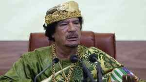 Libyan leader Moamer Kadhafi addresses African parliamentarians during a meeting in Tripoli on September 9, 2009.