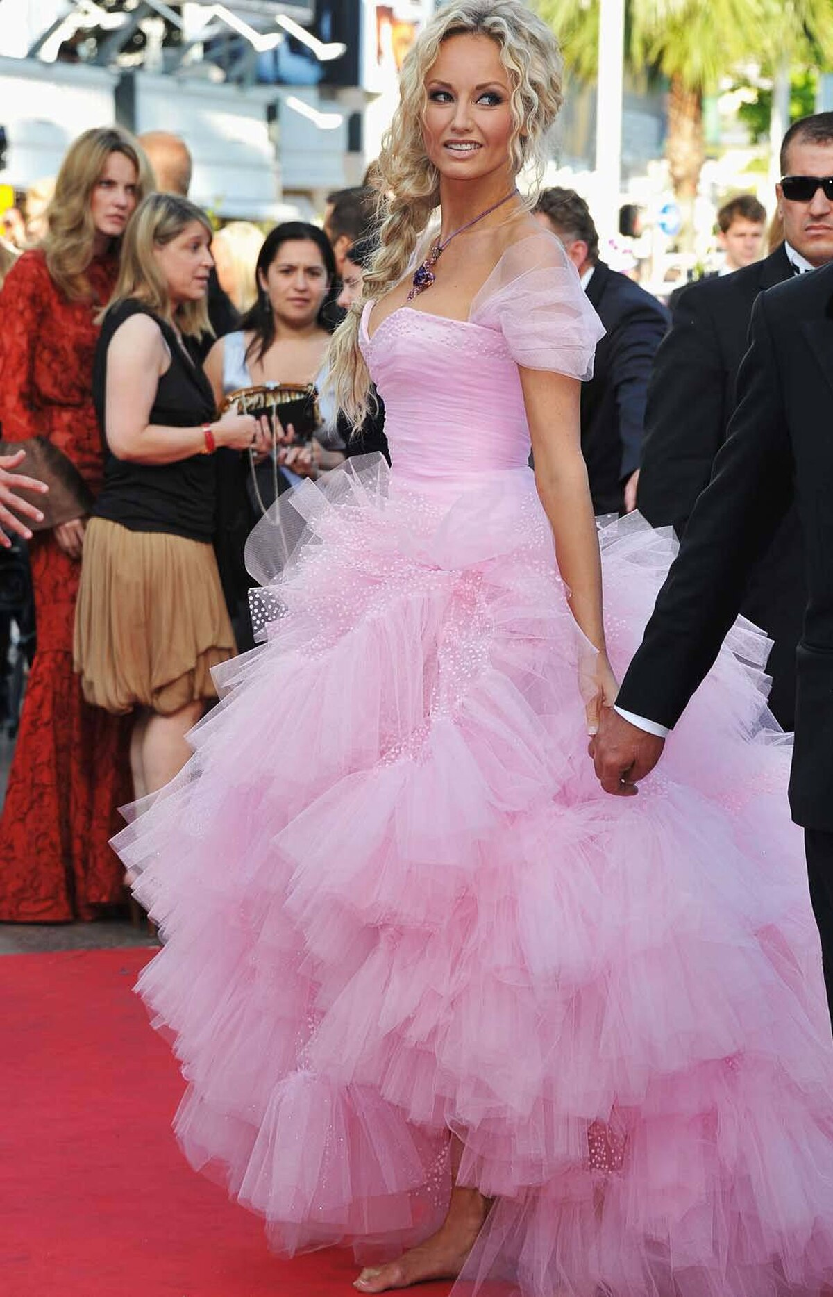 """Bare-footed model Adriana Karembeu attends """"The Beaver"""" premiere at the Cannes Film Festival on Tuesday."""