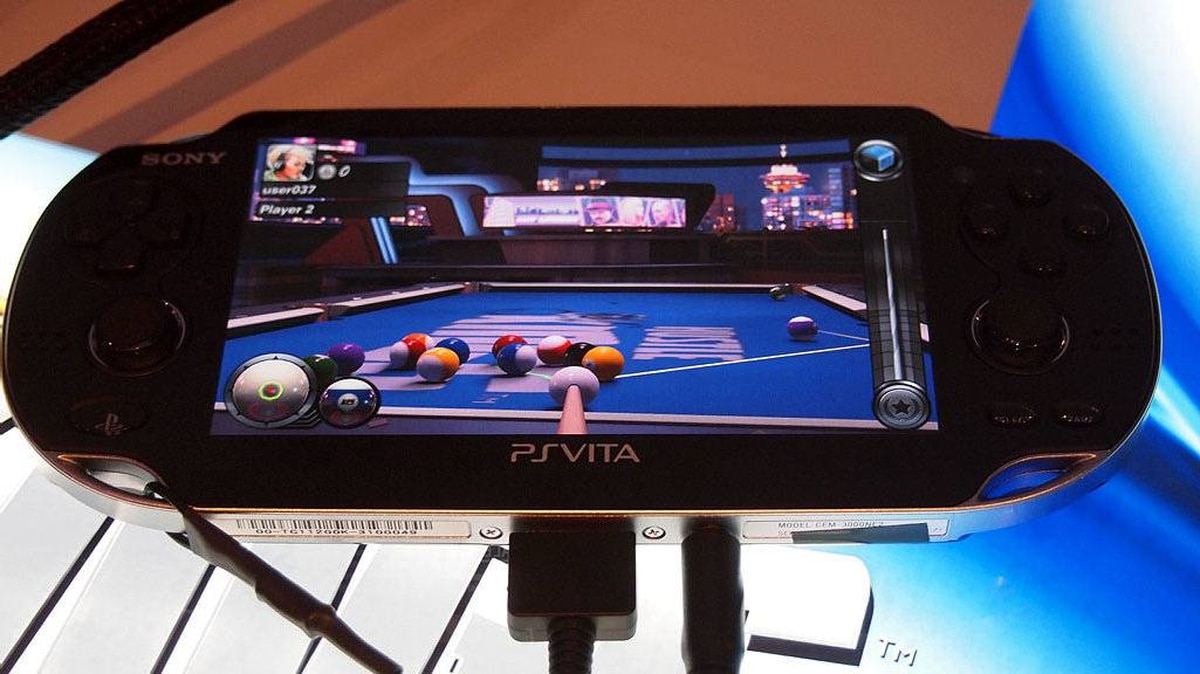 Game blogger Chad Sapieha lines up a shot in Hustle Kings, a billiards game for the PlayStation Vita.