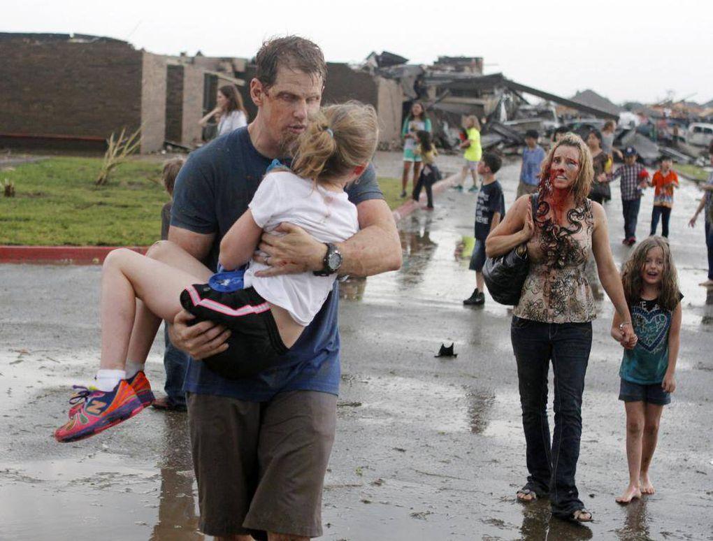 In pictures: Tornadoes wreak havoc across U.S. states