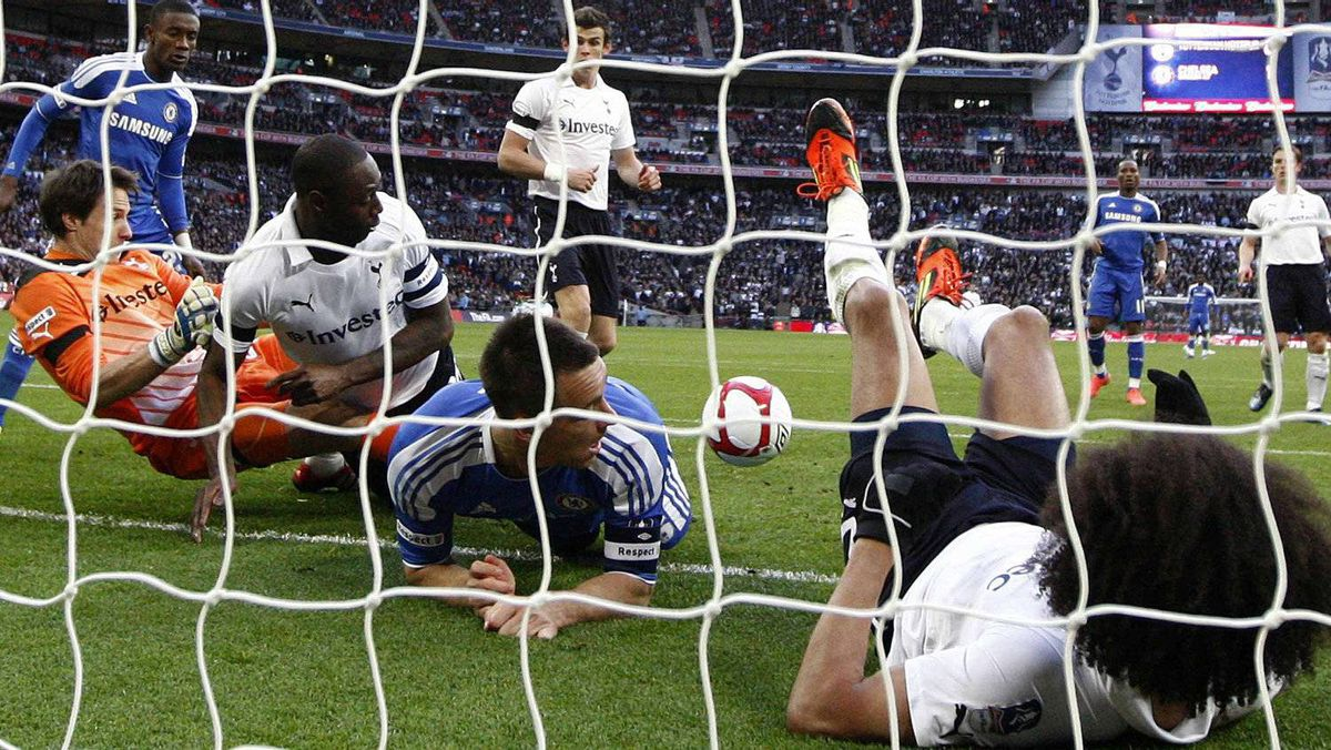 Chelsea and Tottenham Hotspur players block a shot from Chelsea's Juan Mata, which was controversially awarded as a goal, during their FA Cup semi-final soccer match at Wembley Stadium in London, April 15, 2012. Chelse won 5-1. REUTERS/Eddie Keogh