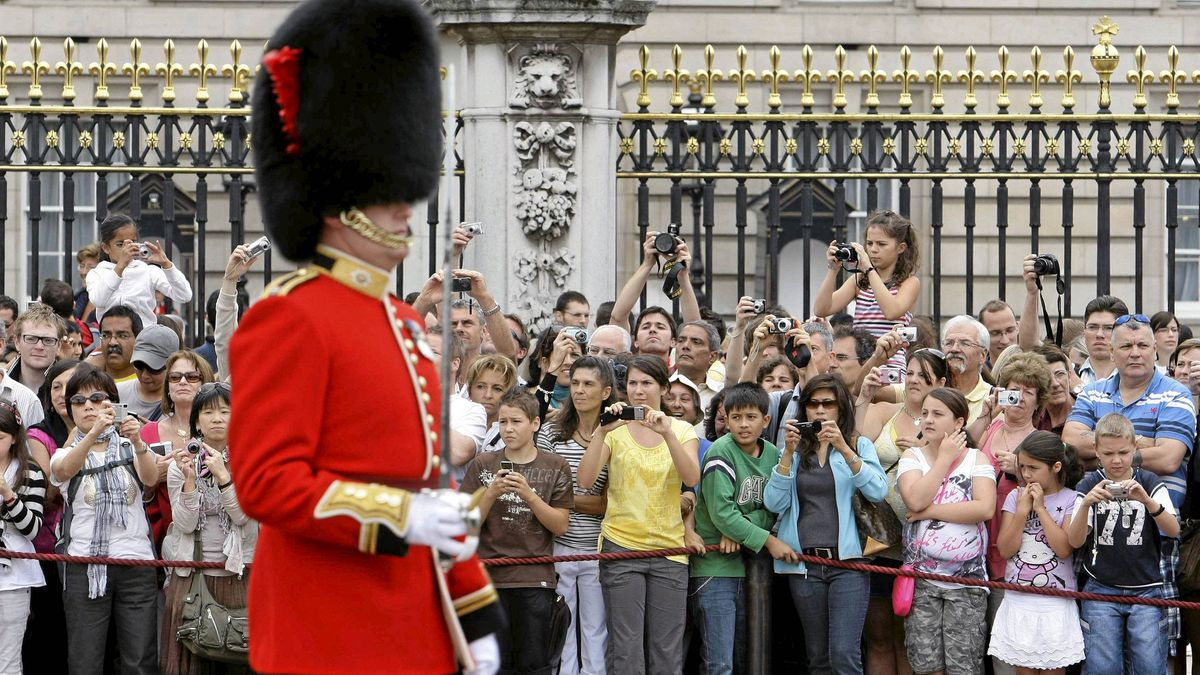 Tourists take pictures of the Changing of the Guard Ceremony at Buckingham Palace, in central London.